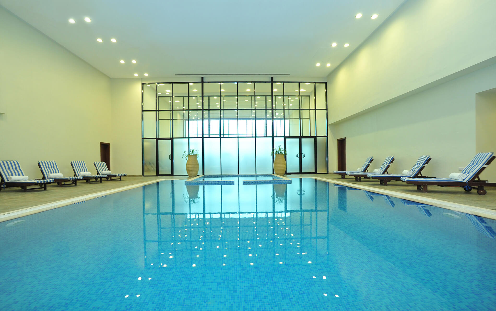 "{""id"":12,""facility_id"":11,""lang_id"":1,""hotel_id"":201000004,""name"":""Indoor Swimming Pool"",""slug"":""indoor-swimming-pool"",""description"":""<p>Whether you want to cool down and ease those aching muscles after a workout or simply take a relaxing swim, take a dip in the temperature-controlled indoor swimming pool. What&rsquo;s more, with a separate a kid&rsquo;s pool, this is the perfect place for the whole family to enjoy a fun escape from the heat of the day.<\/p>\r\n\r\n<p>Ramada Hotel &amp; Suites by Wyndham Ajman offers. It also offers swimming lessons for kids to provide your children with the confidence and freedom to enjoy swimming and water-based recreation, under the supervision of a professional swimming instructor.<\/p>\r\n\r\n<p>[break]<\/p>\r\n\r\n<table class=\""table table-dark table-striped table-bordered\"">\r\n\t<thead>\r\n\t\t<tr>\r\n\t\t\t<th>Facility<\/th>\r\n\t\t\t<th>Timing<\/th>\r\n\t\t<\/tr>\r\n\t<\/thead>\r\n\t<tbody>\r\n\t\t<tr>\r\n\t\t\t<td>Indoor Swimming Pool<\/td>\r\n\t\t\t<td>From 07:00 am to 11:00 pm<\/td>\r\n\t\t<\/tr>\r\n\t<\/tbody>\r\n<\/table>\r\n\r\n<div id=\""selection_bubble\"" style=\""position:absolute;\tvisibility:hidden; padding:15px; color:#333; background-color: white; border: 5px solid black; border-radius:10px; width:300px; z-index:10000\"">&nbsp;<\/div>\r\n\r\n<div id=\""selection_bubble\"" style=\""position:absolute;\tvisibility:hidden; padding:15px; color:#333; background-color: white; border: 5px solid black; border-radius:10px; width:300px; z-index:10000\"">&nbsp;<\/div>\r\n\r\n<div id=\""selection_bubble\"" style=\""position:absolute;\tvisibility:hidden; padding:15px; color:#333; background-color: white; border: 5px solid black; border-radius:10px; width:300px; z-index:10000\"">&nbsp;<\/div>"",""sort"":3,""status"":1,""created_at"":""2019-10-30 07:41:00"",""updated_at"":""2019-12-17 11:05:03"",""deleted_at"":null,""image_slider"":{""id"":1227,""lang_id"":1,""image_sliderable_id"":12,""image_sliderable_type"":""App\\HotelFacility"",""image_slider"":""uploads\/image-slider\/1eecd0c1f72758c97043853ec93f2ac01574061457.jpg"",""name"":null,""sub_name"":null,""content"":null,""status"":1,""created_at"":""2019-11-18 07:17:37"",""updated_at"":""2019-11-18 07:17:37"",""sort"":null,""is_mobile"":0}}-slider"